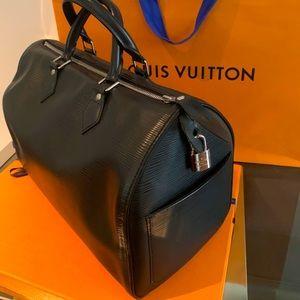 Louis Vuitton Épi leather speedy 35 bag.